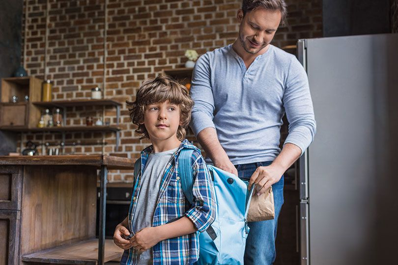 father packing son's lunch