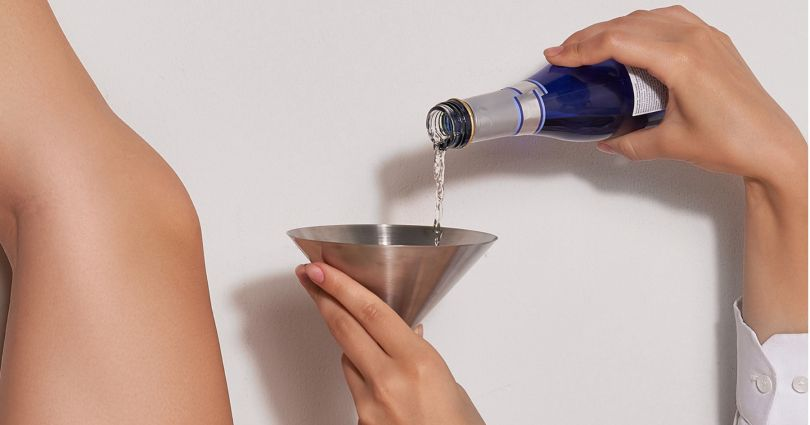 woman pouring drink
